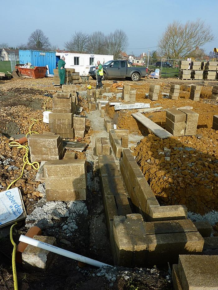 Concrete blocks being laid on West wall