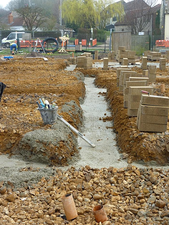 Concrete laid on second foundations