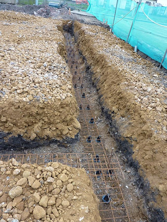 Ditch showing foundation reinforcing in place 1