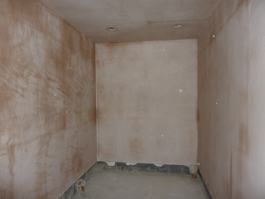 Gents toilet walls plastered