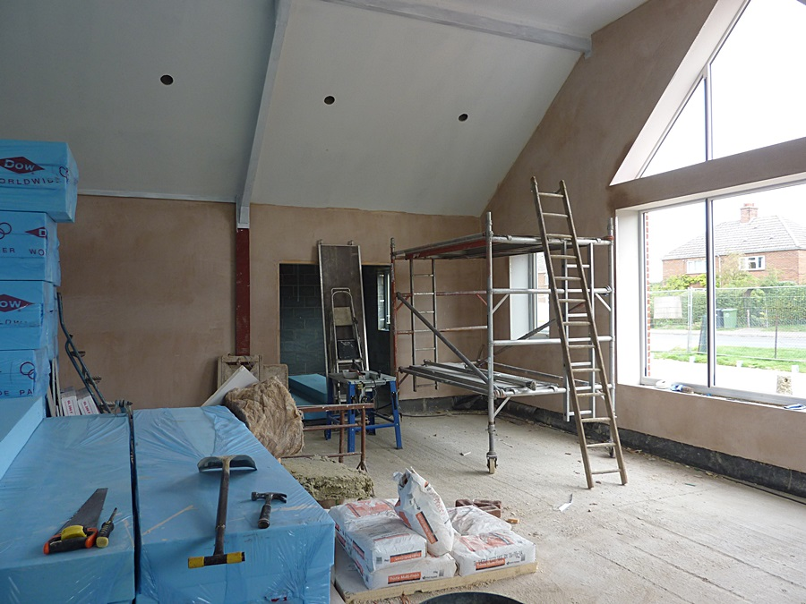 Main hall North wall plastered